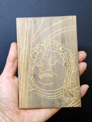 手に持った写彫仏(不動明王)